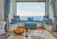 Take in the sea views from the dining table