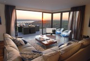 Open plan living and dining area with stunning vistas