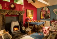 The heart of the cabin is the cosy living room with roaring log fire